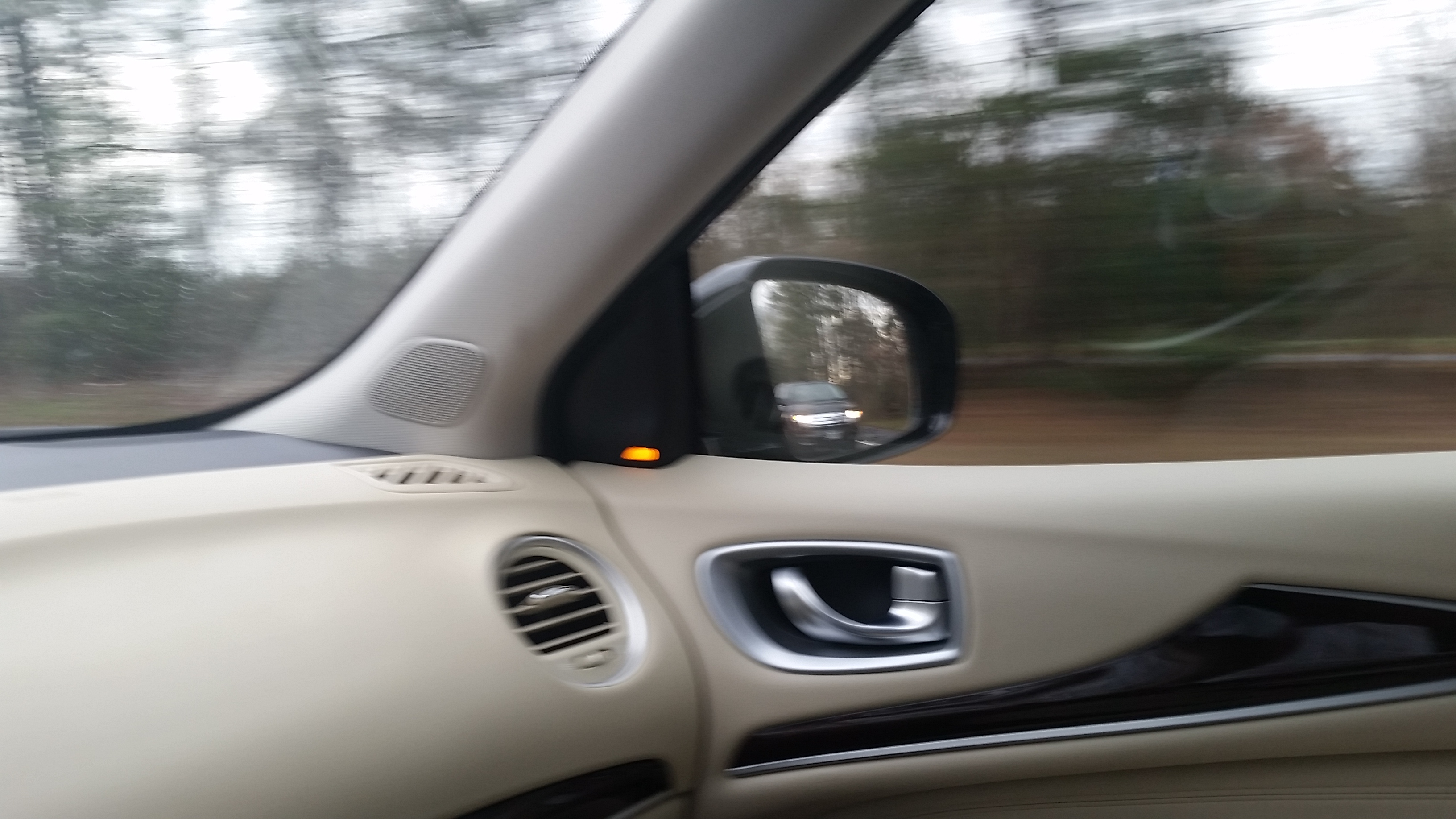 Infiniti's Active Safety Display features Blind Spot Warning light on each door.