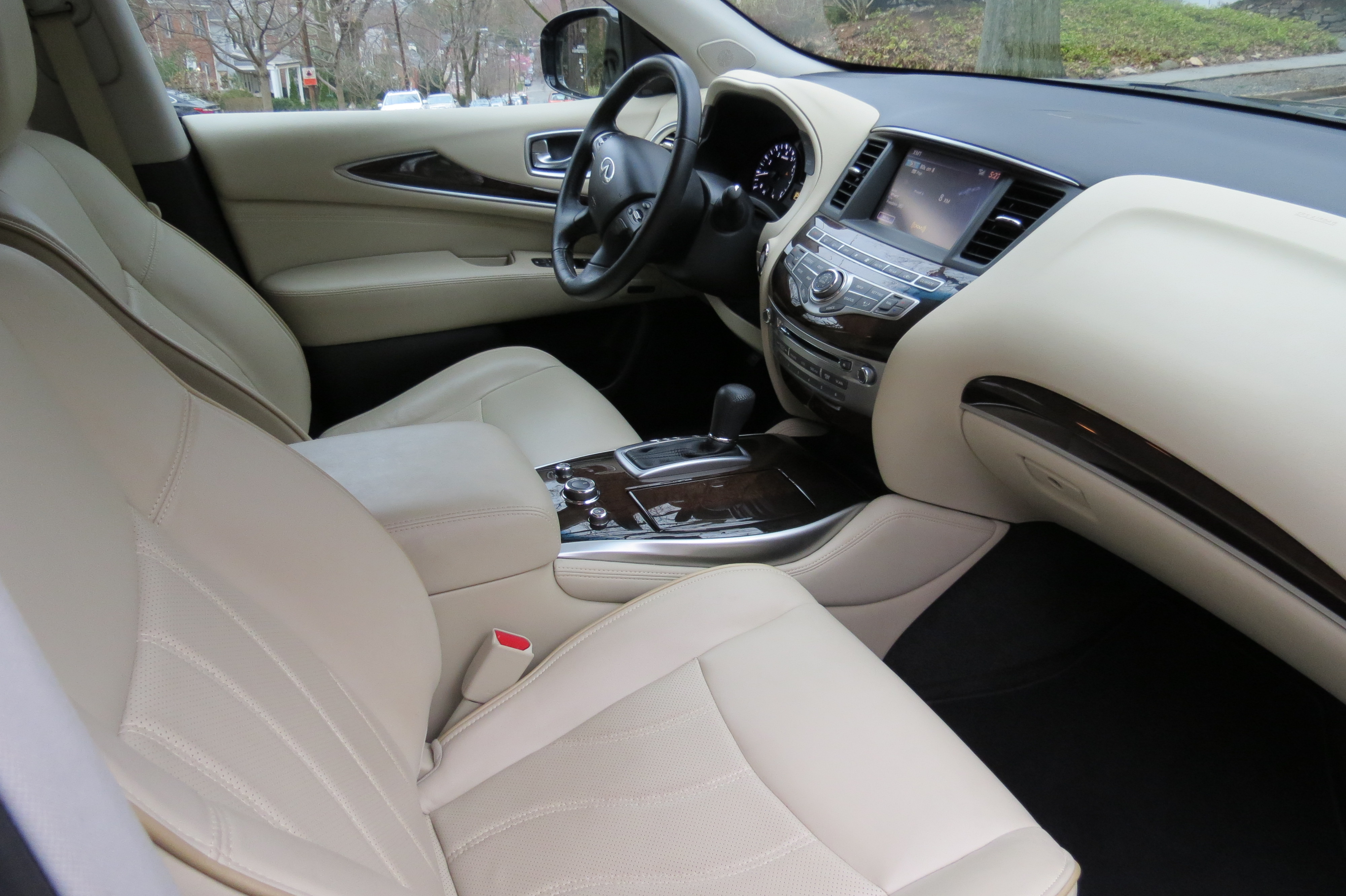 The inside of the Infiniti QX60 features wheat colored leather and maple wood trim accents.