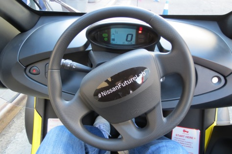 Looking inside the cockpit of the Nissan Mobility Concept Vehicle. A very simple dashboard with basic controls.