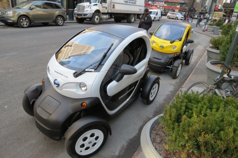 "The Nissan ""Twizzy"" or Neighborhood Electric Vehicle, a small battery powered people transporter."