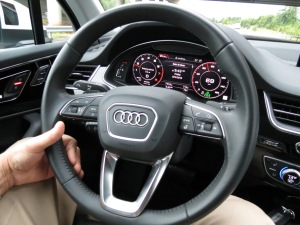 The Audi Q7 Dashboard, features a screen with analog style gauges and plenty of information for the driver.
