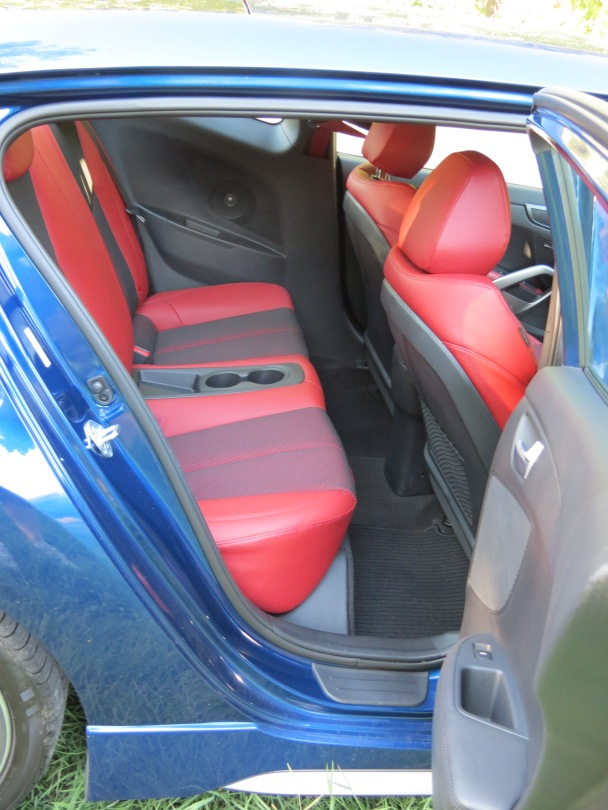 Plenty of leg room, but not headroom, for two rear passengers in the Hyundai Veloster.