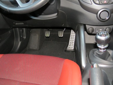 Studded chrome sport pedals are some of the many extras in the Hyundai Veloster R-Spec, a lot of sports car, for very little money.