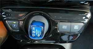 Prius's gear selector is a stalk and separate button, which may cause some confusion.