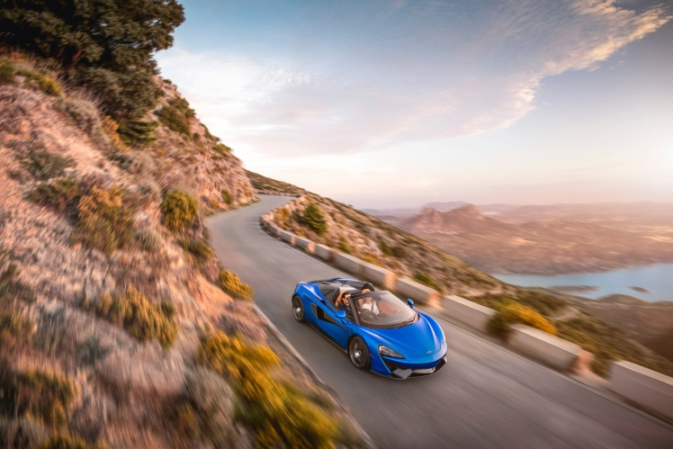 McLaren 570S Spider top down on the open road.