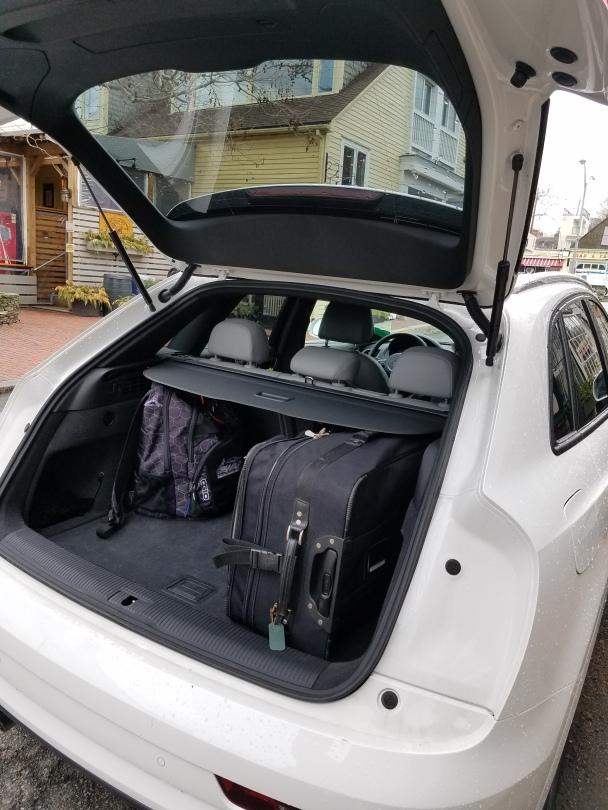 Audi Q3 hatchback design allows for cargo area access.