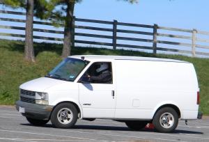 White Chevrolet Astro Van Autocrossing