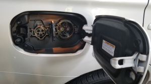 Mitsubishi PHEV has two Charge ports for Level 1 & 2 and DC Fast Charging