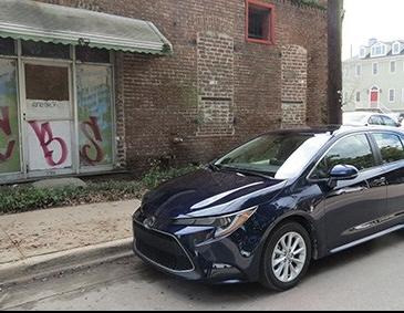 2020 Toyota Corolla in Savannah GA with historic brick wall backdrop