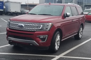 2018 Ford Expedition Ruby Red Metallic head on shot