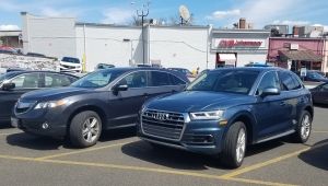 The Audi Q5 at CVS in Washington DC, with an Acura RDX