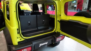 Suzuki Jimny features a full rear door with fold down rear seats for more cargo space.