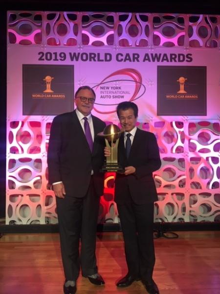 Marty Haynes and Suzuki Exec accept World Urban Car for the Jimny