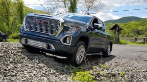 2019 GMC Sierra Denali Pickup Truck climing a gravel hill