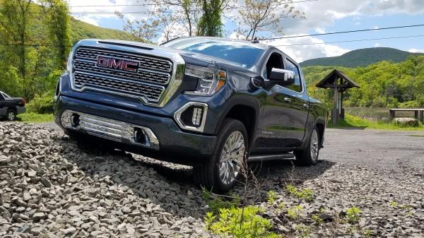 2019 GMC Sierra Denali Pickup Truck climing a gravel hill