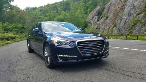 Genesis G90 Parked in front of a rock face