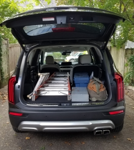 2020 Kia Telluride cargo area 2nd row split down loaded with ladders and tool bag.