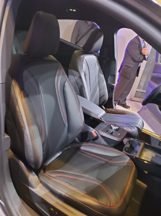 Ford MachE interior with stitched seats, cupholders and places for two mobile phones to charge.