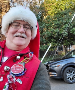 William West Hopper festivly dressed for the 2019 Old Town Alexandria Virginia Scottish Walk Parade in front of a 2019 Mazda CX5