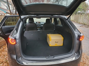 Mazda CX 5 with the hatch open and rear seats folded down.