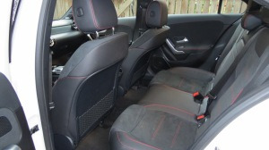 Rear Seats in the A220. Seats are black DINAMICA with red contrasting stitching.