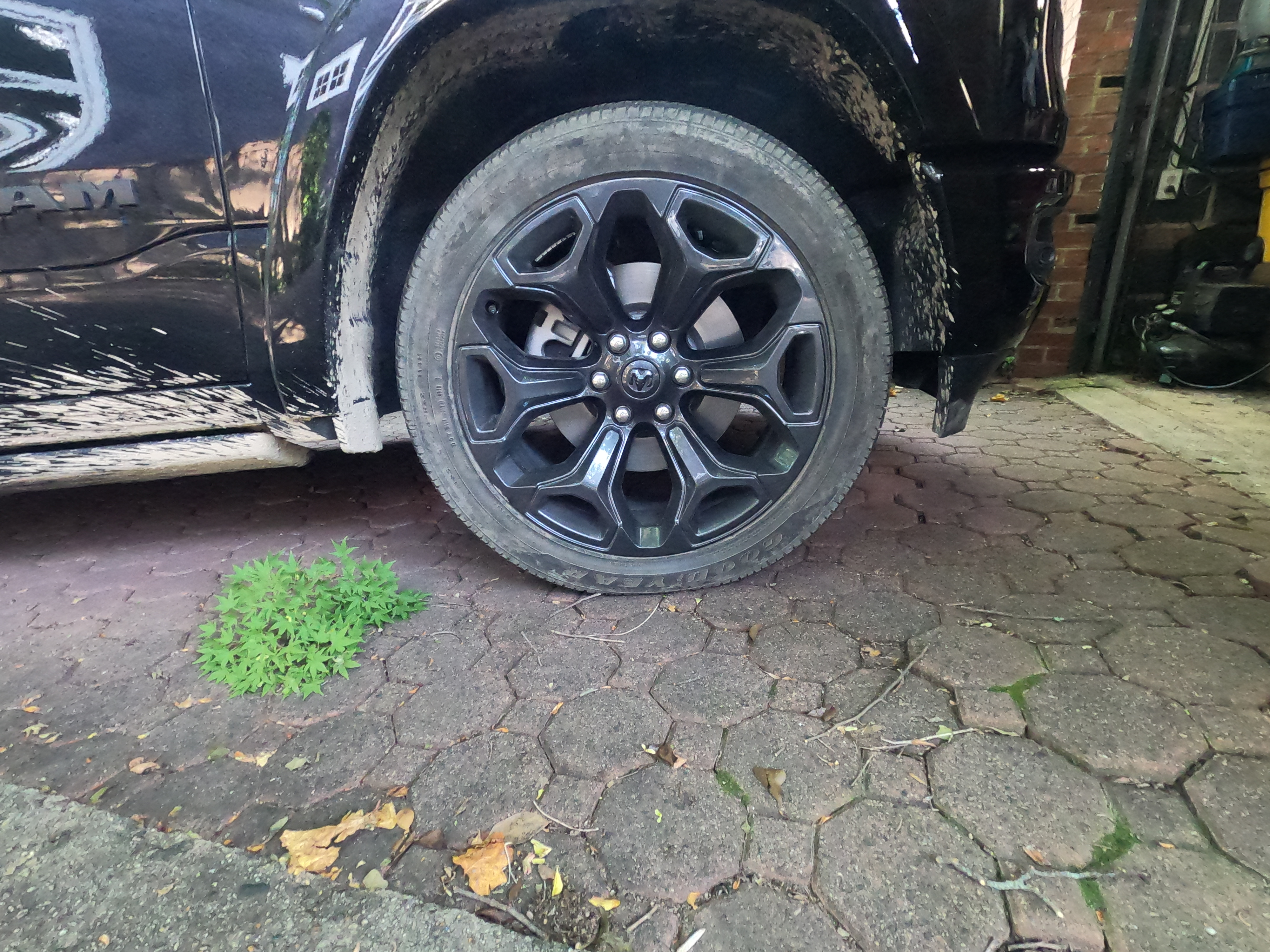 Ram 1500 22 by 9 inch black rims with Goodyear tires