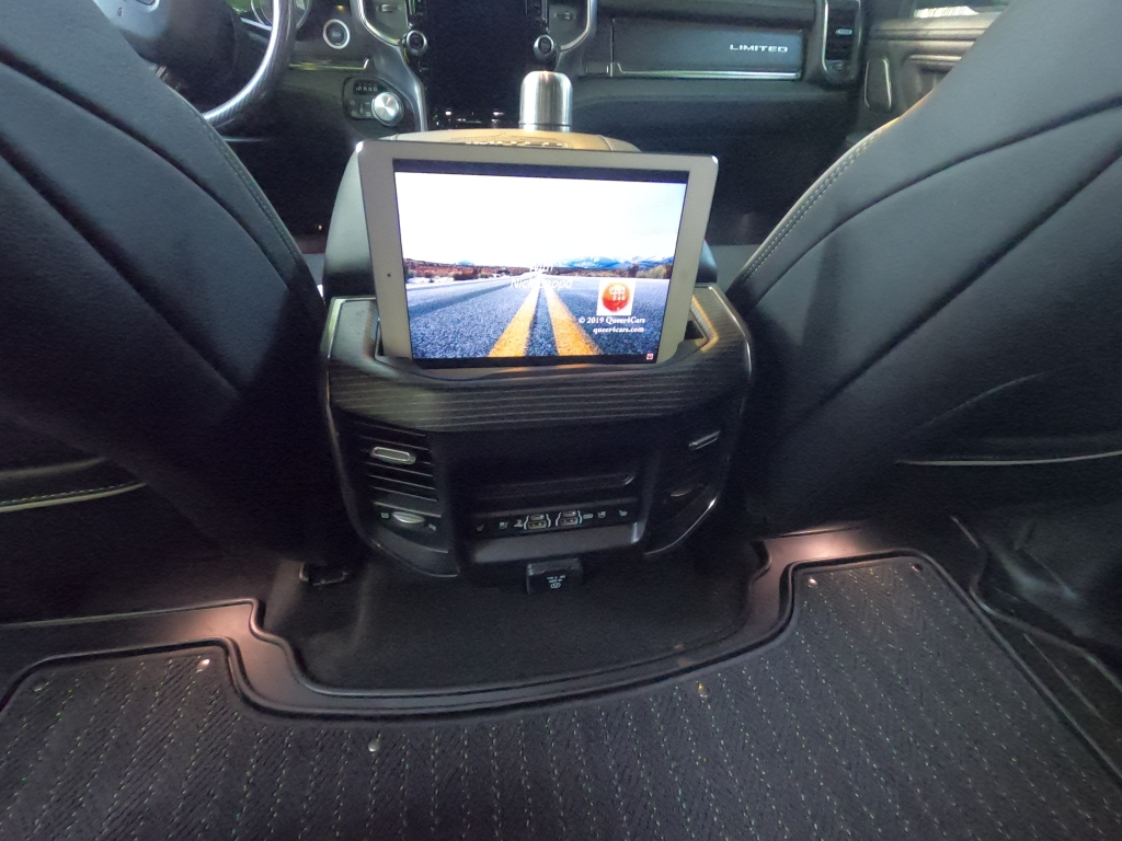 Ram 1500 center console holds an ipad with the queer4cars youtube channel