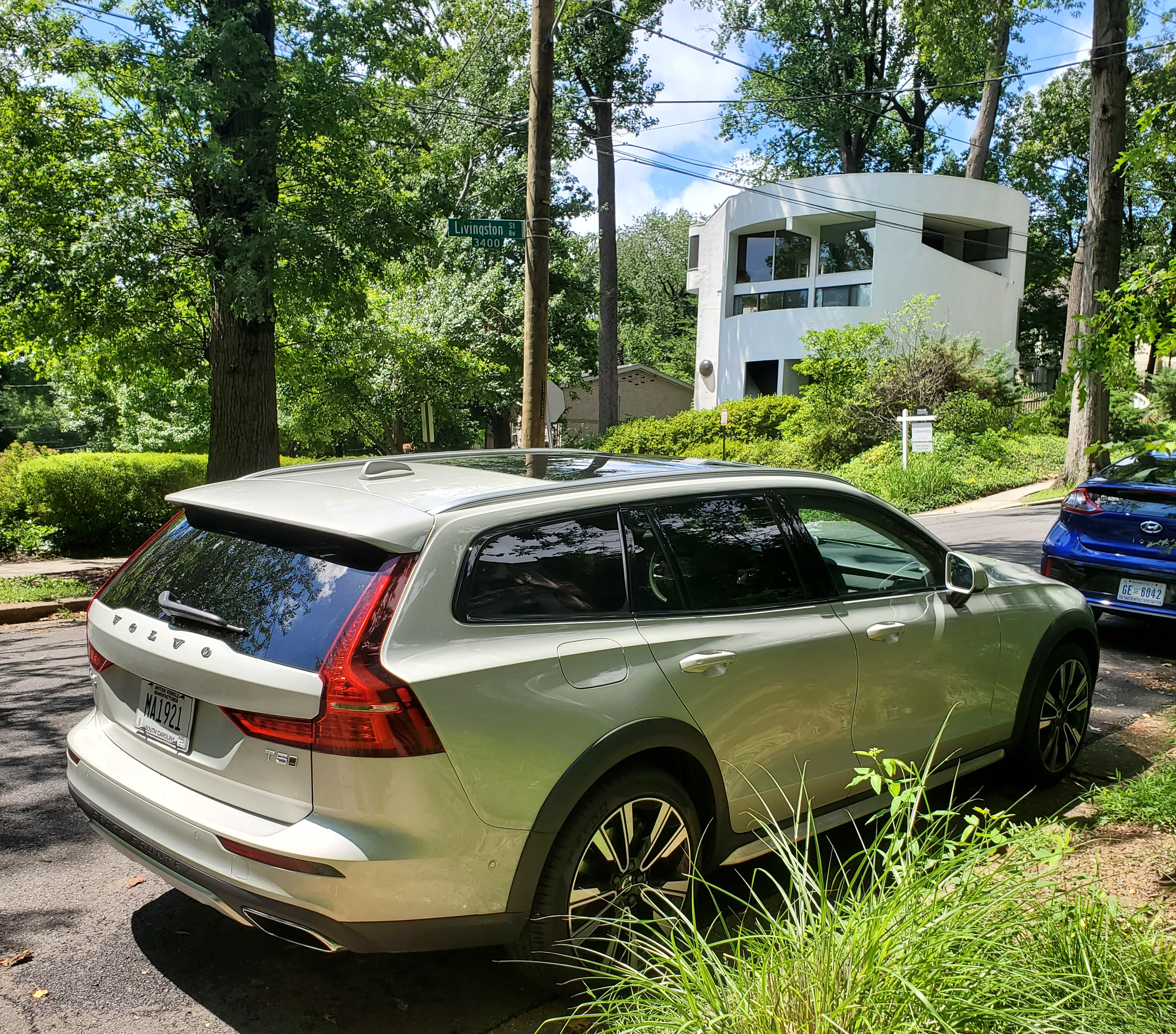2020 Volvo V60 Right Rear with modern house in background