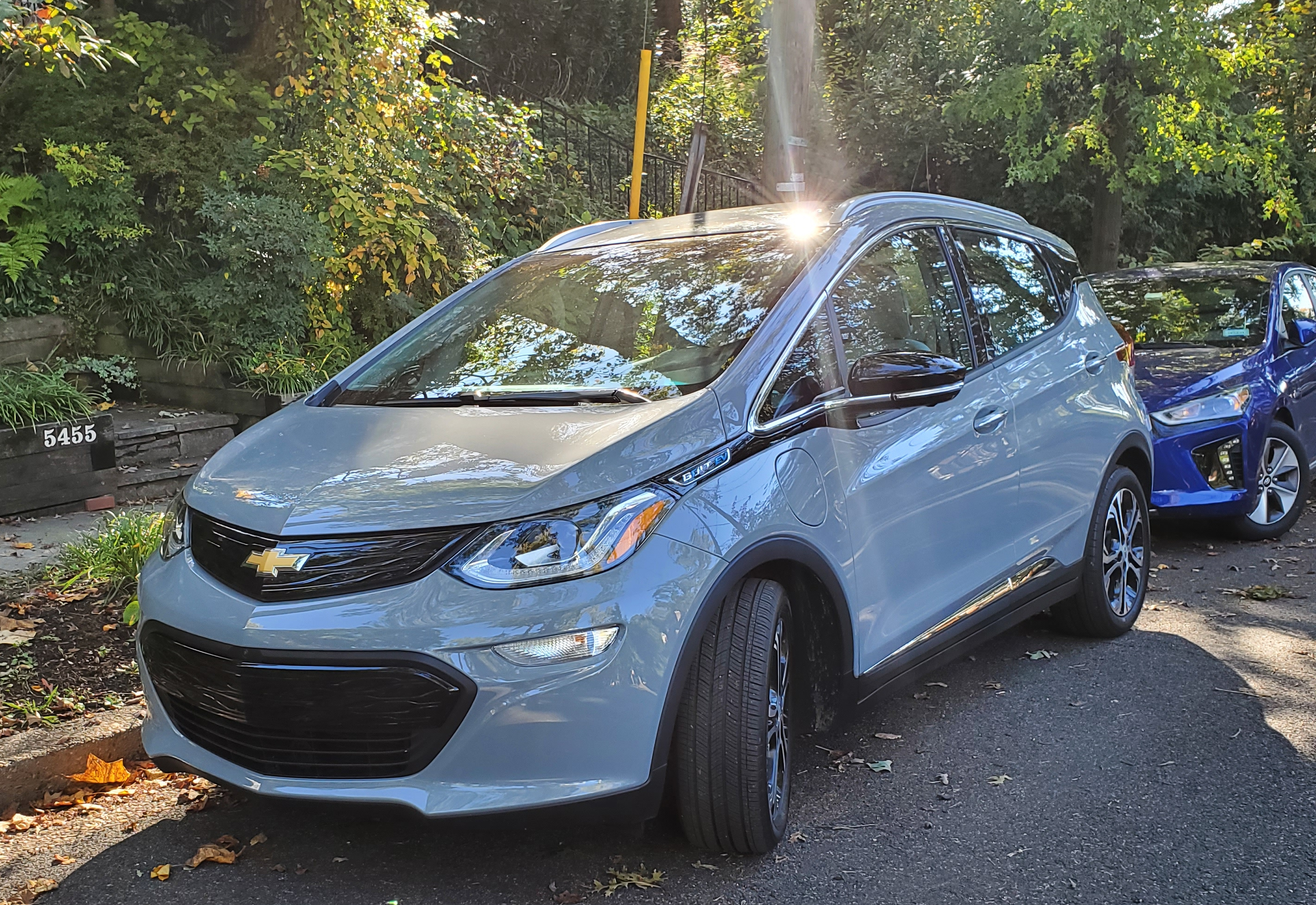 2020 Chevy Bolt EV with a 2019 Hyundai Ioniq Electric behind it.
