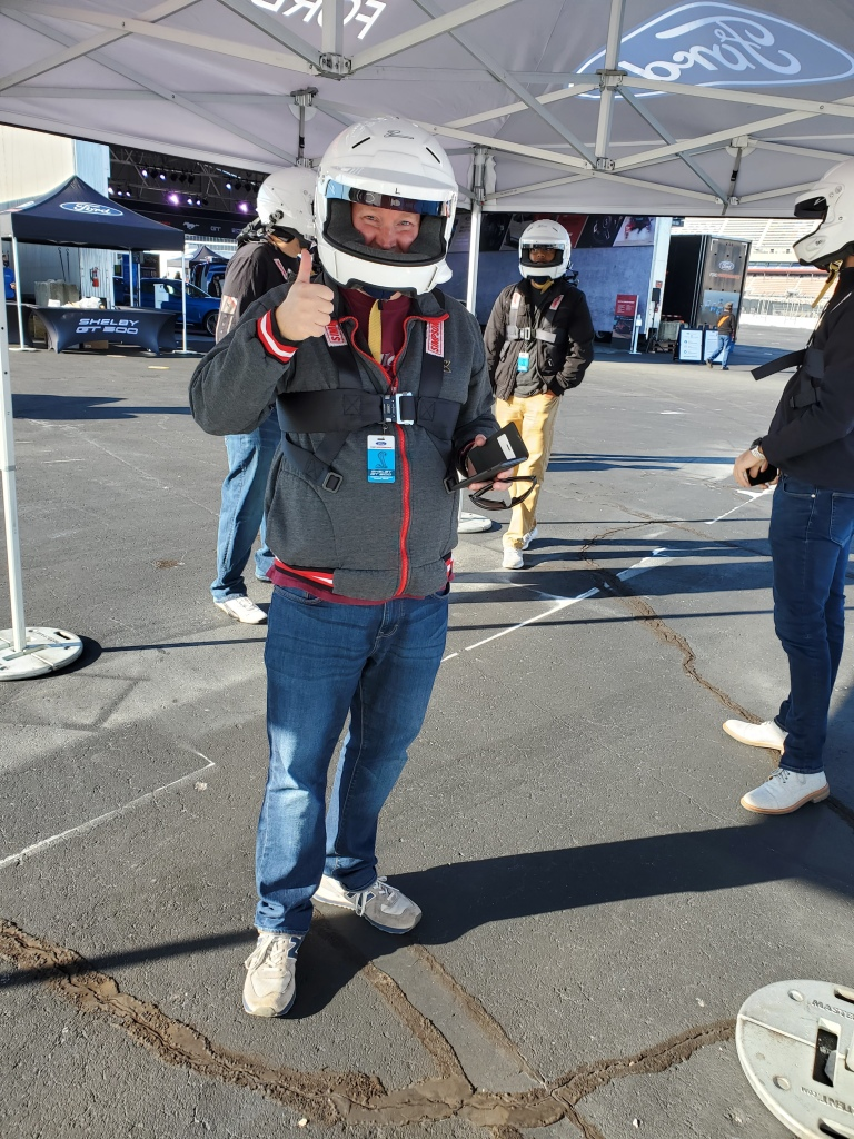 Officer Matt Rihl helmeted and harnessed up prior to driving a SHELBY GT 500 on the Charlotte Motor Speedway Track at speed. October 19 2020