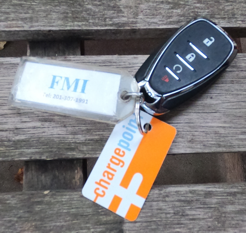 The key fob for the Chevrolet Bolt EV. we had access to the ChargePoint EV charger network, and the vehicle was managed by FMI.