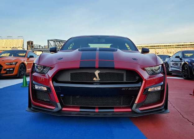 A red SHELBY GT 500 with black hood stripes at Charlotte Motor Speedway ready to be taken out on the track at the North American Track Tour October 19 2020