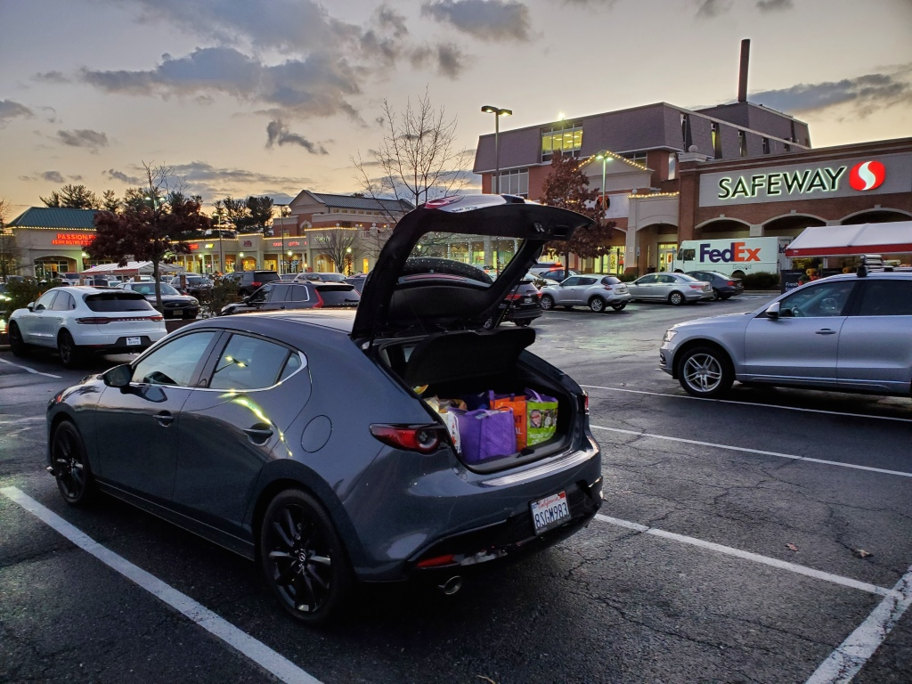 2021 Mazda3 with hatch open at Safeway store