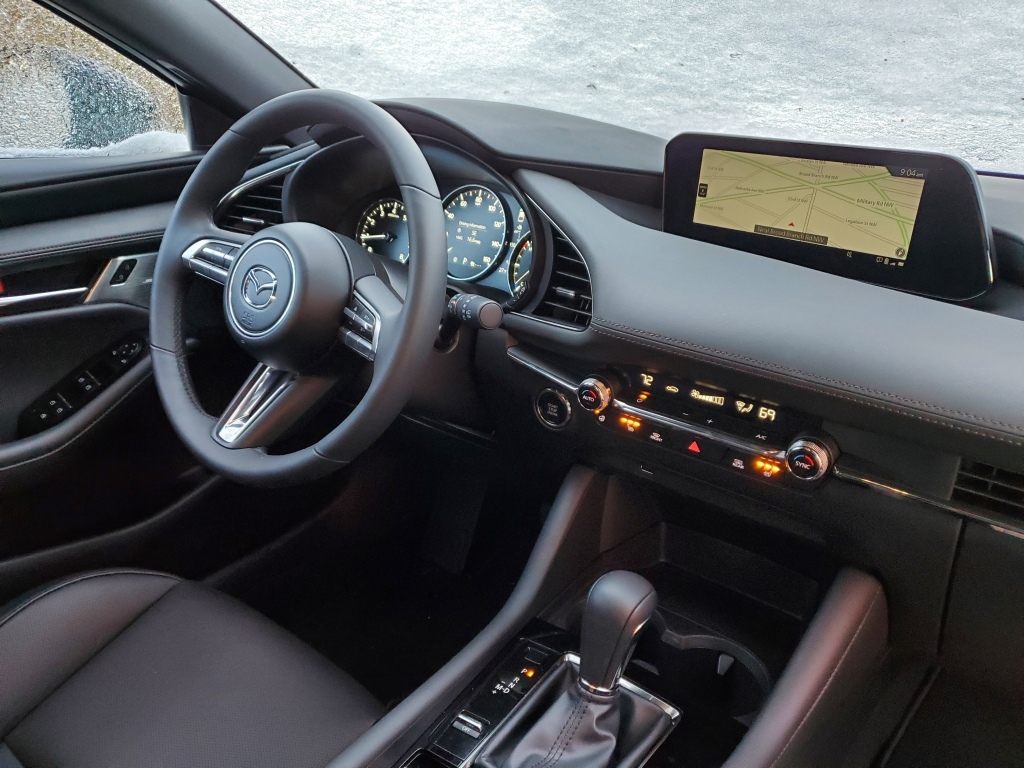 The cockpit of the 2021 Mazda3 hatch
