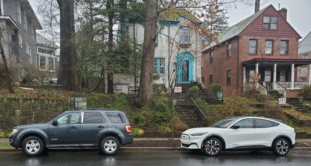 Ford Escape Hybrid and Mustang Mache parked in front of homes in Washington DC