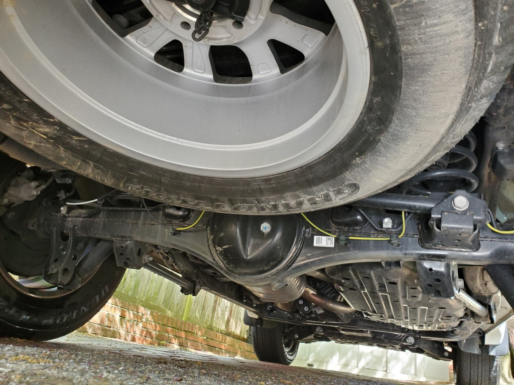 Underneath the Land Cruiser is plenty of skid plates and a full-size spare tire.