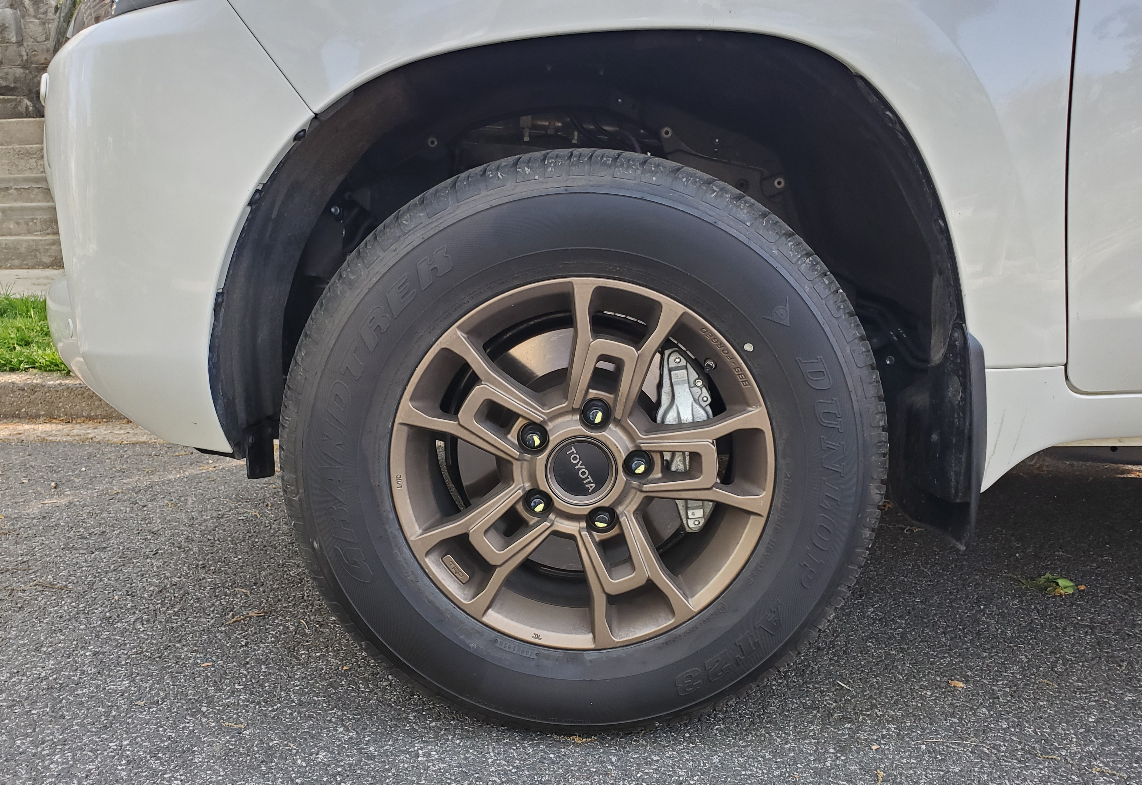 Custom BBS TRD identified 18-inch alloy wheels hold the large Dunlop Tires