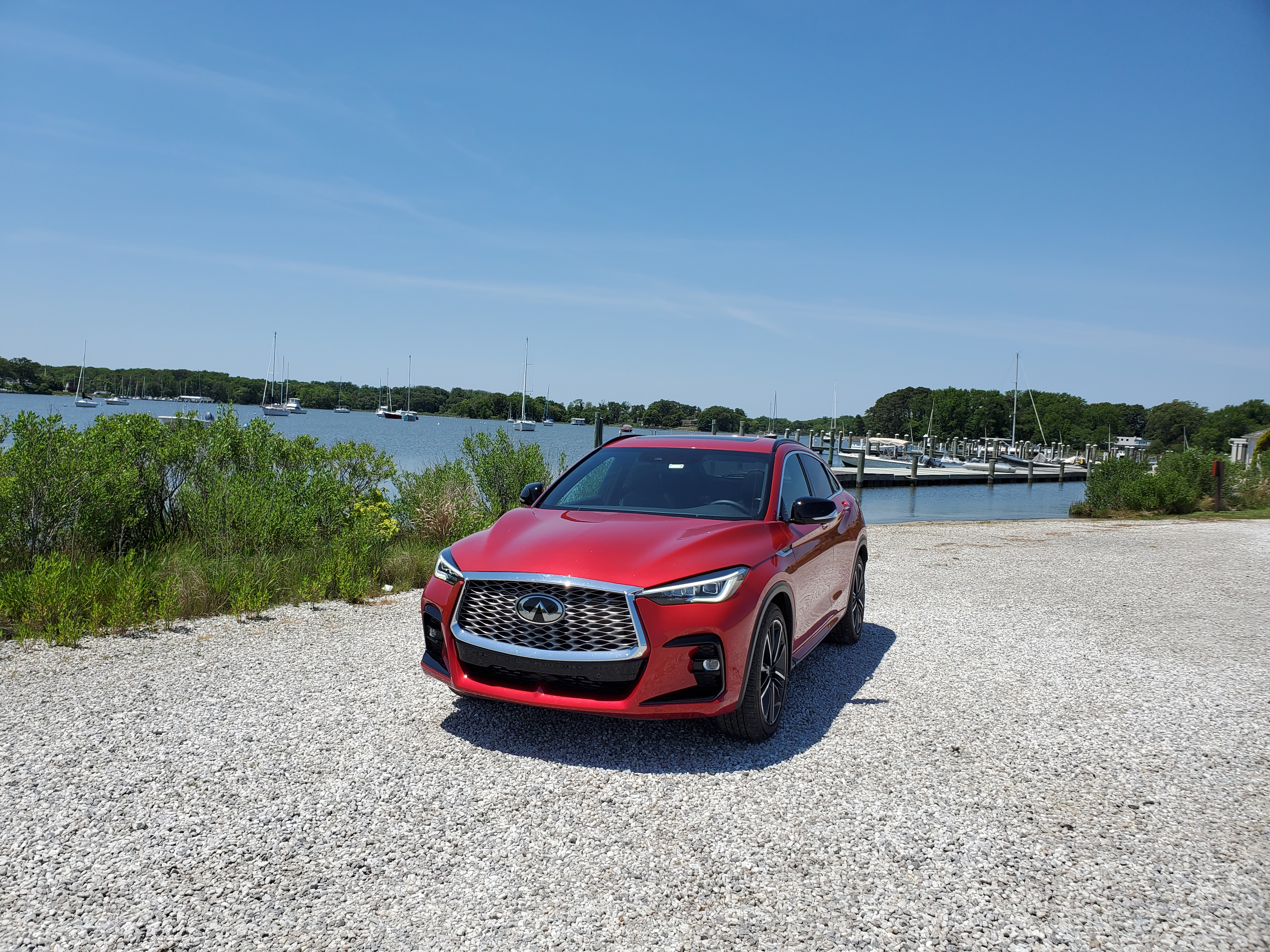 Infiniti QX55 Front on with boats in the background