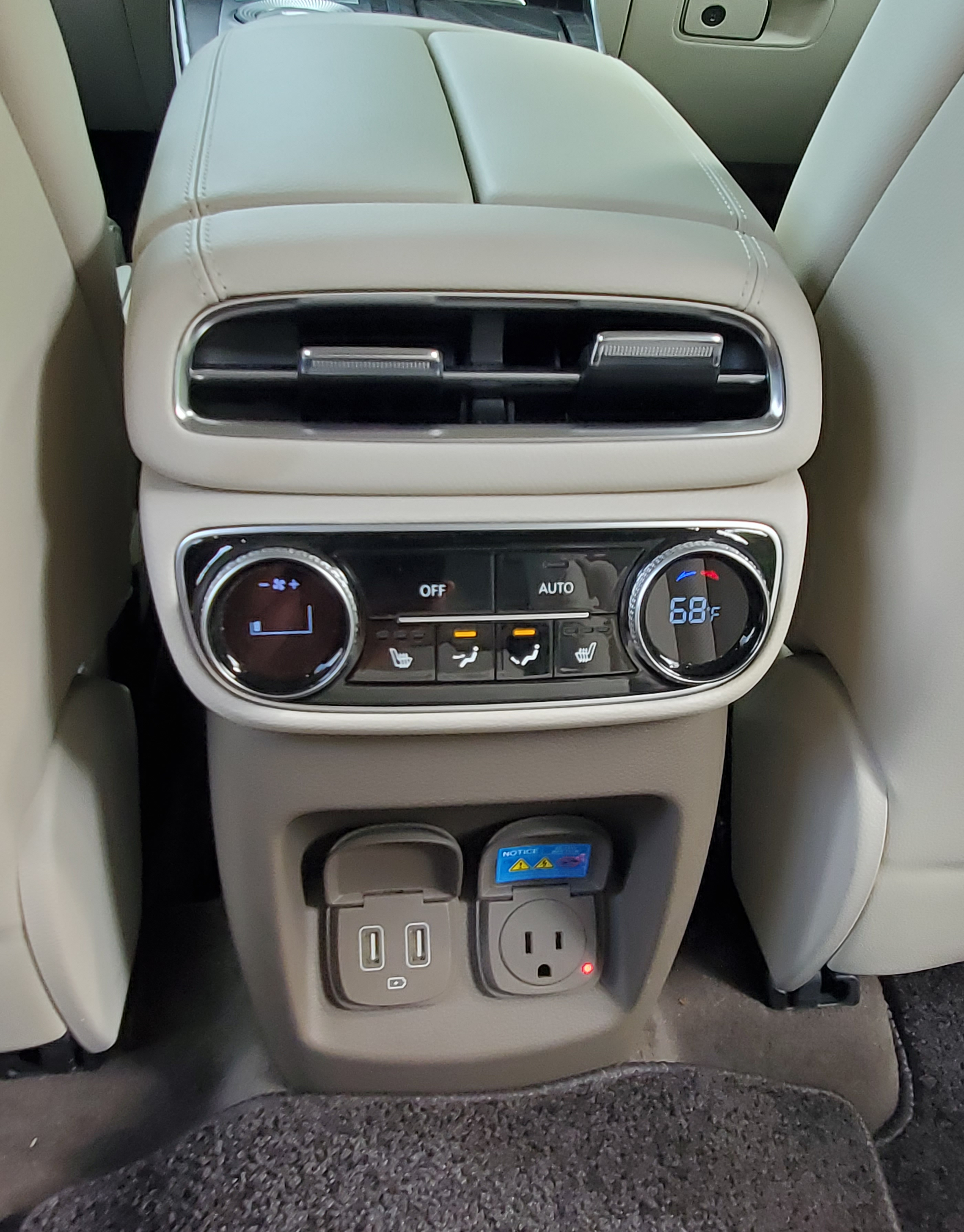 GV80 rear console with HVAC controls and power outlets