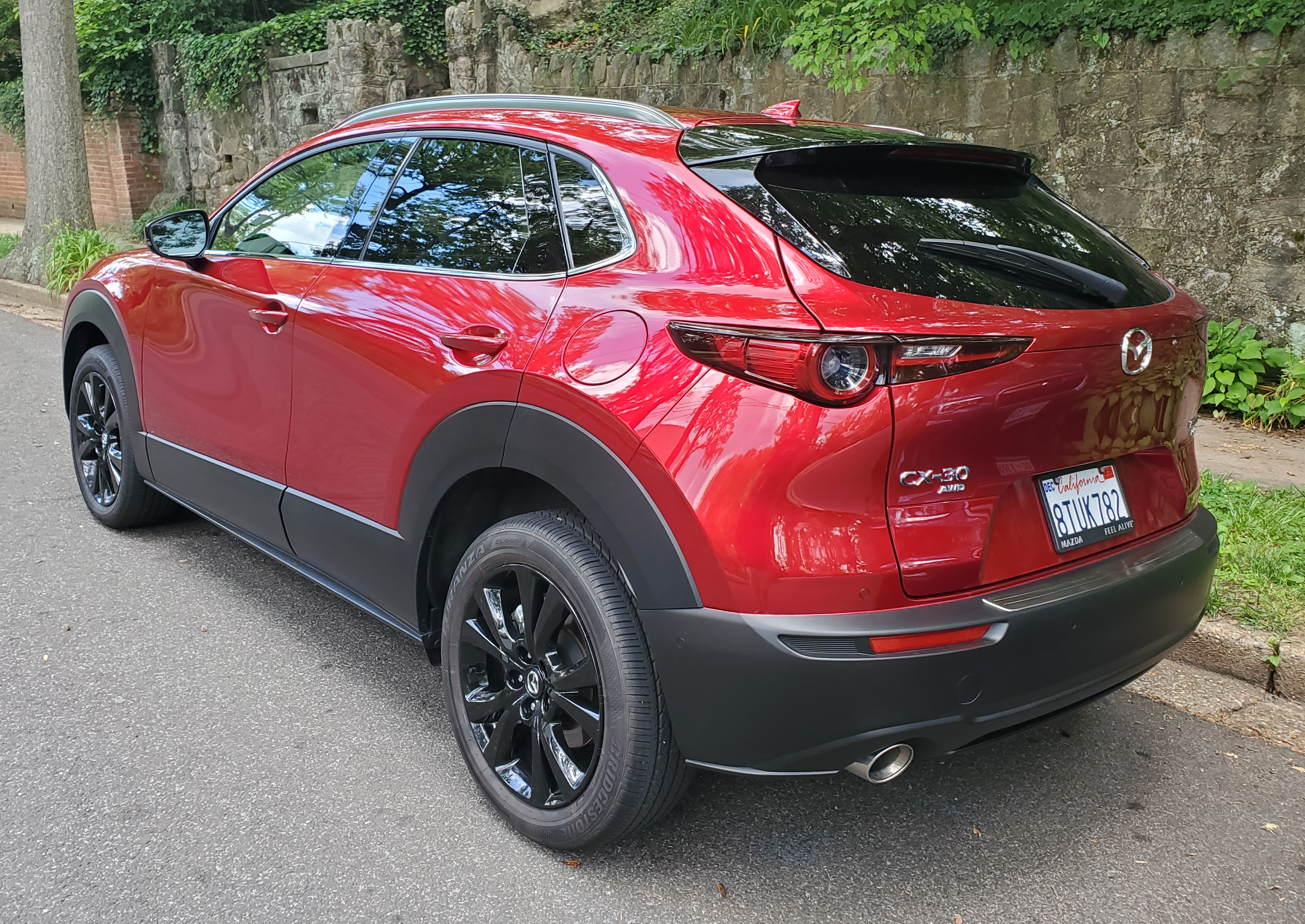 left rear of the mazda cx 30 in soul red crystal metallic