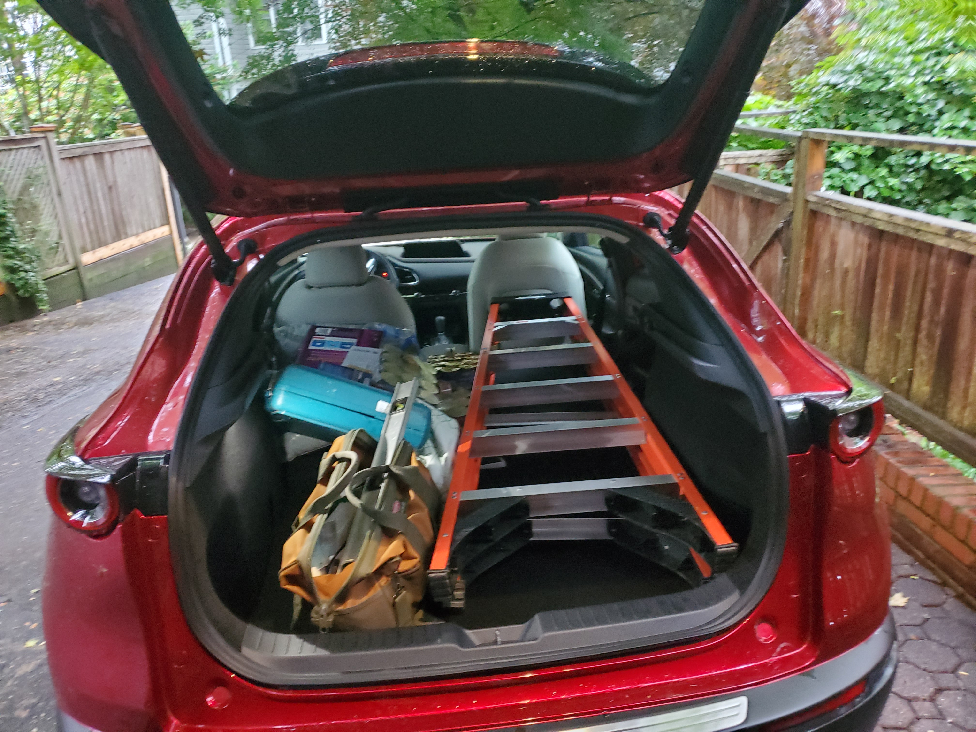mazda cx 30 with ladder in the back