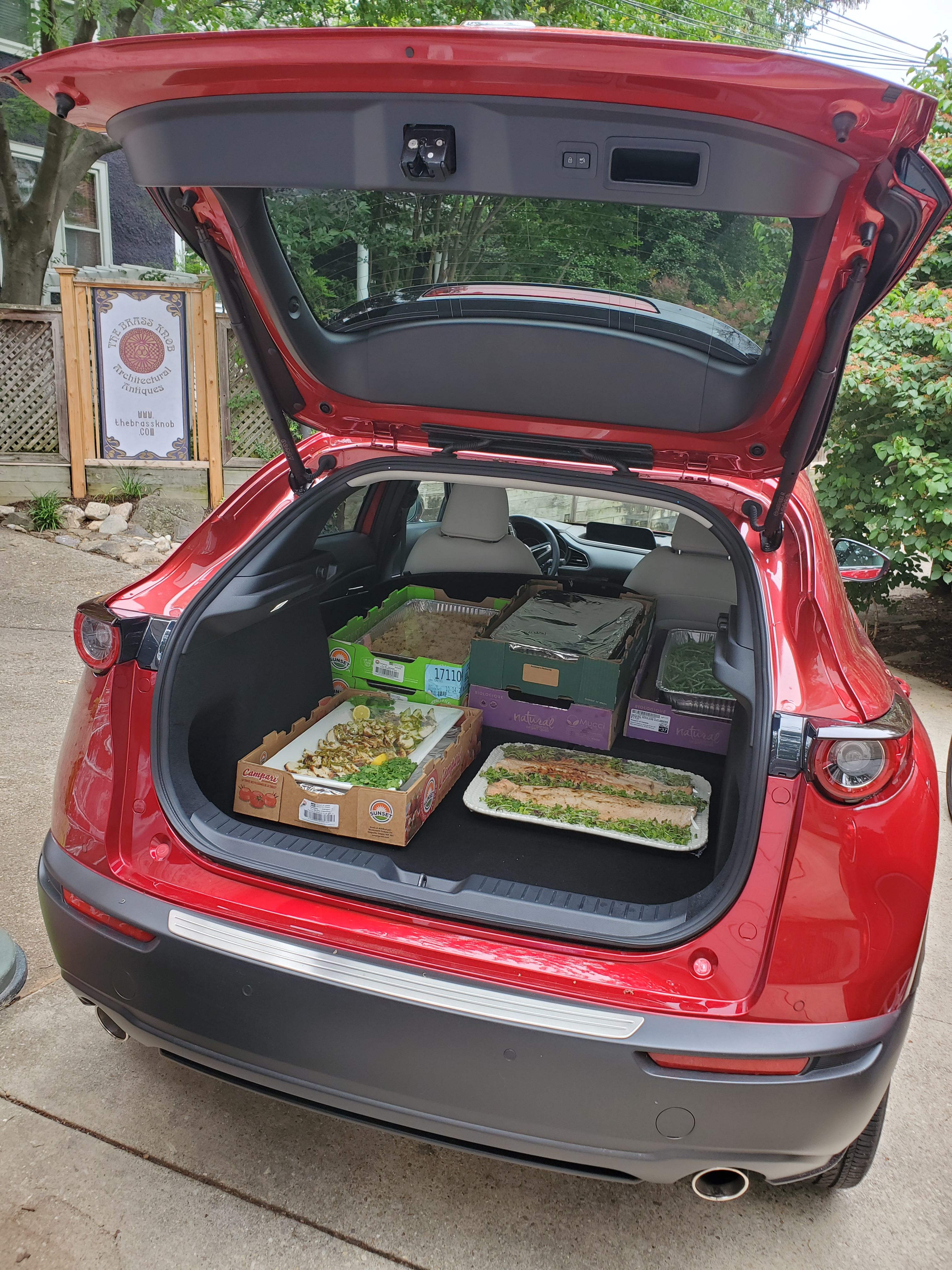 cx30 cargo area loaded with trays of food