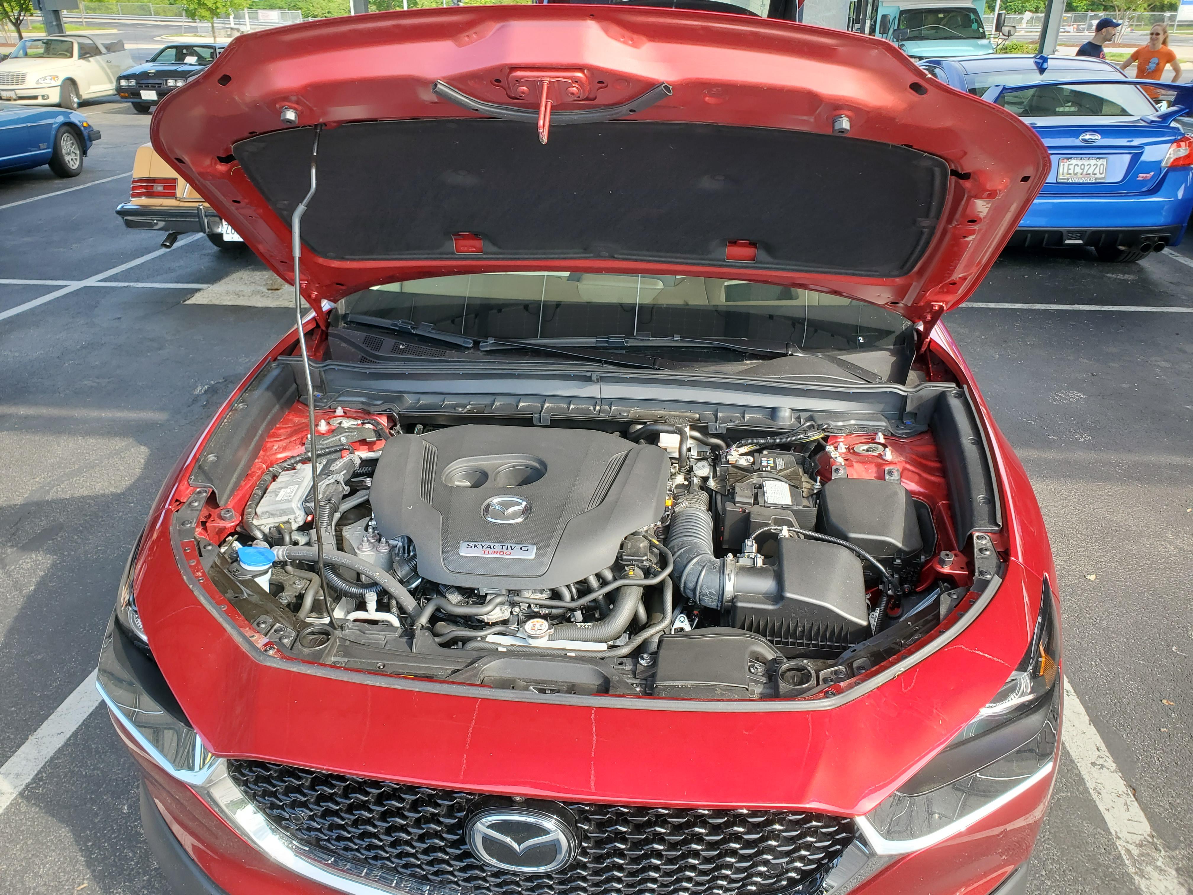 hood open showing the 2.5 skyactiv turbocharged engine of the mazda cx30
