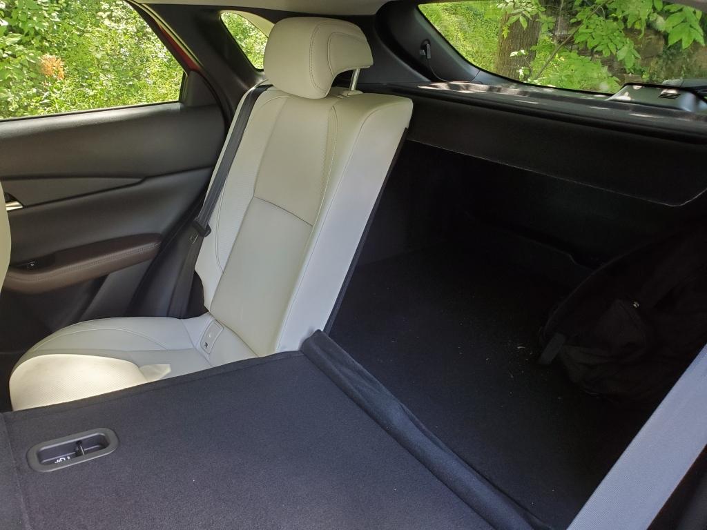 left rear seat folded down in the mazda cx30
