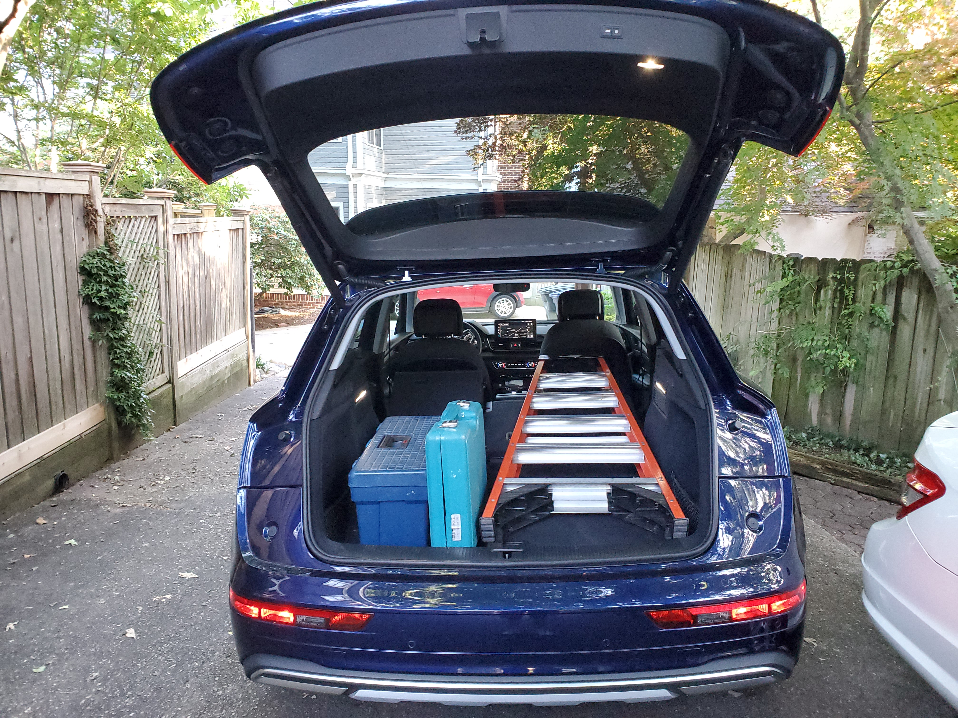 Audi Q5 cargo hatch open with ladder and tools