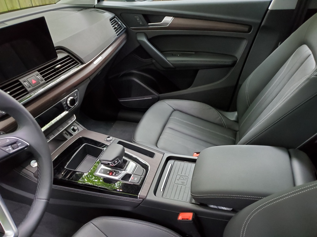 The wireless device charger is center on the console